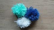 Hoe kun je een pompoen pompom maken op karton