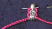 Sieraden maken elastieken armband knopen met kralen