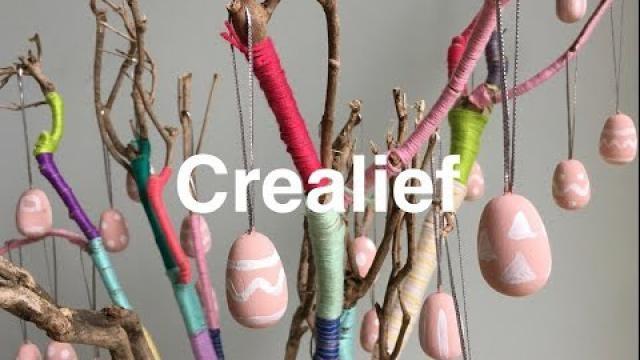 Makkelijk-paastakken-versieren-met-gekleurde-wol